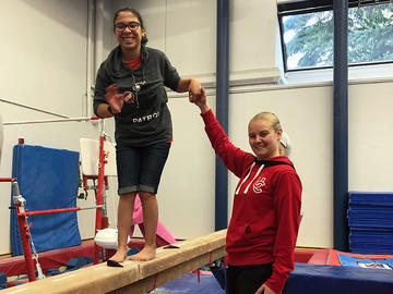 Adapted camp participant on balancing beam